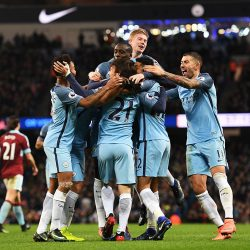 MANCHESTER, ENGLAND - JANUARY 02:  Gael Clichy of Manchester City is mobbed by team mates after scoring the opening goal during the Premier League match between Manchester City and Burnley at Etihad Stadium on January 2, 2017 in Manchester, England.  (Photo by Shaun Botterill/Getty Images)